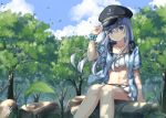 1girl alternate_costume bikini blue_eyes blue_headwear blue_sweater blush cap feet_out_of_frame frilled_bikini frills hibiki_(kantai_collection) kantai_collection leaf long_hair looking_at_viewer midriff miko_fly navel silver_hair sitting solo sweater swimsuit tree tree_shade