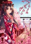 1girl absurdres black_bow bow bridge brown_eyes brown_hair cherry_blossoms cherry_tree collarbone day earrings eyebrows_visible_through_hair fate/grand_order fate_(series) floating_hair hair_between_eyes hair_bow hair_ribbon highres holding holding_umbrella ishtar_(fate/grand_order) japanese_clothes jewelry kimono long_hair long_sleeves looking_at_viewer outdoors print_kimono red_kimono red_ribbon red_umbrella ribbon shaffelli solo standing torii twintails umbrella very_long_hair wide_sleeves yukata