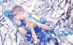 1girl absurdres anastasia_(fate/grand_order) bangs bare_shoulders blue_dress blue_eyes blue_flower blurry blurry_foreground blush clouds commentary_request day depth_of_field dress eyebrows_visible_through_hair fate/grand_order fate_(series) flower hair_flower hair_ornament hair_over_one_eye hands_together hands_up highres junpaku_karen leaf_print long_hair outdoors own_hands_together parted_lips print_dress puffy_short_sleeves puffy_sleeves short_sleeves shoulder_cutout silver_hair snow solo tree_branch very_long_hair