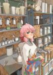1girl airbrush akashi_(kantai_collection) alternate_costume commentary_request green_eyes hair_ribbon highres hood hooded_robe hoodie indoors kachi_(kachi5100) kantai_collection long_hair long_sleeves looking_at_viewer paint_can pink_hair pitcher ribbon shelf solo tress_ribbon upper_body