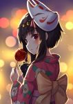 1girl alternate_costume apple bangs bell black_hair blurry blurry_background blush bow candy commentary_request eyebrows_visible_through_hair food fox_mask fruit hair_bell hair_ornament holding japanese_clothes kimono kono_subarashii_sekai_ni_shukufuku_wo! large_bow looking_at_viewer mask mask_on_head megumin pensuke red_eyes sidelocks solo yellow_bow yukata