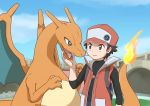 1boy backpack black_hair blue_eyes brown_eyes cap charizard enon fangs hand_on_another's_chin hat long_sleeves looking_at_each_other pokemon pokemon_(creature) pokemon_(game) red_(pokemon) smirk tongue vest
