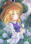 1girl absurdres animal_print blonde_hair flower frog_print hair_ribbon highres holding leaf medium_hair moriya_suwako purple_skirt purple_vest rain ramie_(ramie541) ribbon skirt touhou vest wet