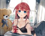 1girl ahoge bangs bare_arms bare_shoulders black_camisole blue_eyes blush camisole cellphone curtains eyebrows_visible_through_hair go-toubun_no_hanayome hair_ornament highres holding holding_cellphone holding_phone indoors long_hair looking_at_viewer lying nakano_itsuki niii_(memstapak) on_stomach parted_lips phone pillow redhead solo star star_hair_ornament strap_slip stuffed_animal stuffed_toy teddy_bear under_covers window