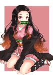 1girl bamboo bit_gag black_hair black_legwear brown_hair commentary fingernails full_body gag hair_ribbon haori highres japanese_clothes kamado_nezuko kimetsu_no_yaiba kimono leg_warmers long_hair long_sleeves looking_at_viewer mouth_hold multicolored_hair obi off_shoulder outside_border pink_background pink_eyes pink_kimono pink_ribbon print_kimono ribbon sandals sash short_kimono sitting solo tabi very_long_hair wariza white_legwear yuito_(yuitokobunasbs0)