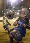 3girls alternate_costume alternate_hairstyle ball city city_lights girls_frontline goalkeeper green_eyes highres hk416_(girls_frontline) kicking miyabino_(miyabi1616) multiple_girls shoes shorts silver_hair sneakers soccer soccer_ball soccer_field soccer_uniform socks sportswear ump45_(girls_frontline)