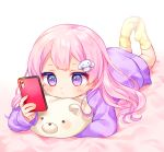 1girl bed_sheet blush bunny_hair_ornament cellphone closed_mouth fingernails hair_ornament holding holding_cellphone holding_phone komachi_pochi legs_up long_hair long_sleeves looking_away lying no_shoes on_stomach original phone pink_hair purple_shirt shirt sleeves_past_wrists socks soles solo violet_eyes yellow_legwear