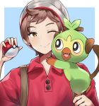 1boy backpack bag beanie blue_background brown_eyes brown_hair commentary_request dan_gan gen_8_pokemon grookey hat highres holding male_protagonist_(pokemon_swsh) poke_ball pokemon pokemon_(creature) pokemon_(game) pokemon_swsh red_shirt shirt short_hair simple_background smile