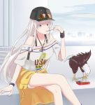 1girl absurdres alternate_costume azur_lane bare_legs baseball_cap bird black_footwear black_headwear black_shorts breasts closed_mouth clothes_around_waist clothes_writing collarbone eagle enterprise_(azur_lane) eyewear_on_headwear food full_body fur_trim hand_up hat highres inflameys jacket jacket_around_waist jewelry long_hair looking_at_viewer necklace off-shoulder_shirt off_shoulder pocky shirt shoes short_shorts shorts sidelocks sign silver_hair skyline smile solo star sunglasses sweatband violet_eyes watch watch white_shirt yellow_jacket