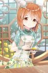 1girl bangs blurry blurry_background blush brown_eyes brown_hair bun_cover closed_mouth commentary_request cup depth_of_field double_bun dress drink drinking_glass eyebrows_visible_through_hair hagiwara_yukiho hair_between_eyes highres holding holding_tray idolmaster idolmaster_million_live! idolmaster_million_live!_theater_days looking_at_viewer mimikaki_(men_bow) short_hair short_sleeves smile solo sparkle table tray white_dress wrist_cuffs