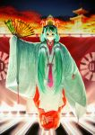 1girl bangs blue_eyes blurry blurry_background character_mask closed_mouth commentary_request depth_of_field eyebrows_behind_hair facing_viewer fan folding_fan glowing green_hair green_kimono hair_between_eyes hair_ornament hatsune_miku headpiece headset highres holding holding_fan japanese_clothes kimono long_hair long_sleeves night night_sky outdoors pagoda print_kimono red_kimono sky sleeves_past_fingers sleeves_past_wrists smile socks solo stage standing tabi twintails v-shaped_eyebrows very_long_hair vocaloid white_legwear wide_sleeves yoka1chi