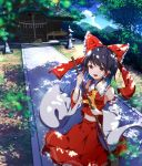 1girl :d absurdres ascot bangs bare_shoulders black_hair blue_sky bow breasts broom brown_eyes clouds commentary_request cowboy_shot day detached_sleeves eyebrows_visible_through_hair frilled_bow frilled_shirt_collar frills hair_bow hair_tubes hakurei_reimu hakurei_shrine highres holding holding_broom huge_filesize long_hair long_sleeves looking_at_viewer midriff navel open_mouth outdoors red_bow red_skirt shadow shide shrine sidelocks skirt skirt_set sky small_breasts smile solo standing touhou tree wide_sleeves yamanakaume yellow_neckwear