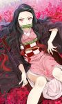 1girl bamboo black_hair forehead frown highres ice_(ice_aptx) japanese_clothes kamado_nezuko kimetsu_no_yaiba kimono long_hair looking_at_viewer lying on_back pink_eyes sash slit_pupils solo very_long_hair