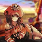 1girl adapted_costume bag_removed bare_shoulders bike_shorts black_gloves breasts brown_eyes brown_hair dress fingerless_gloves gloves guilty_gear guilty_gear_2020 hat highres looking_at_viewer lying may_(guilty_gear) medium_breasts off-shoulder_sweater off_shoulder on_side orange_headwear orange_shirt pirate_hat sergio_nhur shirt skull_and_crossbones smile solo spaghetti_strap sweater sweater_dress v