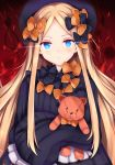1girl abigail_williams_(fate/grand_order) bangs black_bow black_dress black_headwear blonde_hair blue_eyes blush bow closed_mouth commentary_request dress eyebrows_visible_through_hair fate/grand_order fate_(series) forehead hair_bow hat highres long_hair long_sleeves looking_at_viewer noose object_hug orange_bow parted_bangs pixcel polka_dot polka_dot_bow sleeves_past_fingers sleeves_past_wrists solo stuffed_animal stuffed_toy teddy_bear upper_body very_long_hair