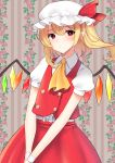 1girl ascot blonde_hair blush center_frills closed_mouth collared_shirt cowboy_shot flandre_scarlet hat hat_ribbon highres looking_at_viewer mizuki_eiru_(akagi_kurage) mob_cap one_side_up pointy_ears puffy_short_sleeves puffy_sleeves red_eyes red_ribbon red_skirt red_vest ribbon shirt short_hair short_sleeves skirt solo touhou vest white_headwear white_shirt wings yellow_neckwear