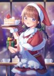 1girl :d absurdres bangs belt blurry blurry_background bow braid brown_hair cake coffee_mug cup eyebrows_visible_through_hair food fruit gift green_bow hair_bow hat highres looking_at_viewer mug open_mouth original pom_pom_(clothes) red_headwear santa_hat slice_of_cake smile solo standing strawberry tachibanashiro17 twin_braids violet_eyes wristband