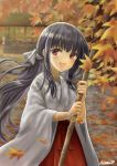 1girl :d absurdres artist_name autumn_leaves black_hair blurry blurry_background blush broom brown_eyes day hakama highres hinari080812 japanese_clothes leaf long_hair maple_leaf miko open_mouth outdoors red_hakama sidelocks smile wide_sleeves
