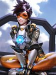 1girl bodysuit brown_hair clouds cloudy_sky crossed_legs goggles highres liang_xing looking_at_viewer overwatch sitting sky smile tagme tracer_(overwatch)