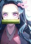 1girl bamboo bangs bit_gag black_hair blush commentary_request forehead gag hair_ribbon highres hoshizaki_reita japanese_clothes kamado_nezuko kimetsu_no_yaiba kimono long_hair looking_at_viewer mouth_hold open_clothes parted_bangs pink_eyes pink_kimono pink_ribbon ribbon signature solo upper_body v-shaped_eyebrows