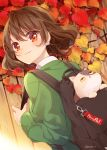 1girl :3 ahoge animal autumn autumn_leaves backpack bag bag_charm blush brown_hair cat cat_earrings charm_(object) closed_mouth day dutch_angle english_text fence from_behind green_sweater hazuki_natsu highres long_sleeves looking_at_viewer looking_back nail_polish original outdoors pink_nails red_eyes short_hair smile solo sweater tareme unzipped upper_body wooden_fence yellow_sclera