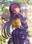 1girl alternate_costume architecture blurry blurry_background breasts cherry_blossoms commentary_request day east_asian_architecture fate/grand_order fate_(series) floral_print grass highres japanese_clothes kimono leaf long_hair looking_at_viewer looking_back nayuta_(una) obi outdoors paper purple_hair red_eyes sash scathach_(fate)_(all) scathach_(fate/grand_order) smile tree wide_sleeves