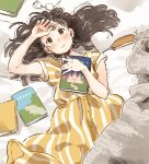1girl absurdres bed blush book brown_eyes brown_hair dress eyewear_removed hair_spread_out hand_on_own_head highres holding holding_book kana_(okitasougo222) long_hair lying on_back on_bed original solo striped striped_dress