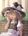 1girl apron arm_up bench black_headwear black_vest blonde_hair blurry blurry_background braid closed_eyes day depth_of_field hair_ribbon hat hat_ribbon head_tilt hedge_(plant) high_collar kirisame_marisa long_hair ookashippo open_hand open_mouth outdoors puffy_short_sleeves puffy_sleeves ribbon shirt short_sleeves single_braid sitting solo touhou tree tress_ribbon very_long_hair vest waist_apron white_shirt witch_hat wooden_bench yawning