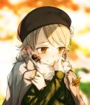1girl autumn_leaves bangs beret black_headwear blonde_hair blurry blurry_background blush brown_eyes clothes_grab drill_hair fur_trim green_sweater hat highres idolmaster idolmaster_cinderella_girls jacket_on_shoulders leaf long_hair long_sleeves looking_at_viewer looking_away maple_leaf morikubo_nono okeno_kamoku ribbed_sweater ringlets self_hug smile solo sweater upper_body