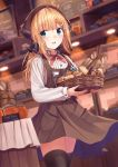 1girl absurdres ahoge apron bakery bangs basket black_legwear black_ribbon blonde_hair blue_eyes blue_skirt blurry blurry_background blurry_foreground blush bread brown_apron commentary_request copyright_request depth_of_field eyebrows_visible_through_hair food hair_ornament hair_ribbon hairclip head_scarf highres holding holding_basket indoors long_hair long_sleeves looking_at_viewer low_ponytail n2_(yf33) name_tag open_mouth orange_juice pen red_neckwear revision ribbon round_teeth shirt shop skirt solo teeth thigh-highs uniform upper_teeth white_shirt zettai_ryouiki