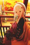 1girl :d abo_(kawatasyunnnosukesabu) autumn backpack bag bag_charm bangs beret black_coat black_skirt blush charm_(object) coat commentary_request day green_footwear hair_ornament hat highres hood hood_down jewelry leaf_hair_ornament long_sleeves looking_at_viewer nail_polish open_mouth orange_shirt original outdoors patting pendant plaid plaid_footwear plaid_shirt plaid_skirt railing red_eyes shirt shoes sitting skirt sleeve_ribbon smile socks socks_over_pantyhose solo train_station white_hair