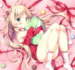 1girl ahoge animal_ears armpit_peek bare_shoulders blonde_hair commentary_request double_bun green_eyes hair_ornament holding holding_pillow knees_together_feet_apart long_hair looking_at_viewer lying neck_ribbon on_back original pan_(mimi) pillow ribbon snowflake_hair_ornament socks solo white_legwear