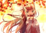 1girl animal_ear_fluff animal_ears autumn_leaves bangs blue_eyes blurry blurry_foreground blush brown_hair commentary_request covered_mouth depth_of_field eyebrows_visible_through_hair floating_hair hamaru_(s5625t) hand_up holding holding_leaf leaf long_hair long_sleeves looking_away looking_to_the_side maple_leaf original pink_sweater poncho ribbed_sweater sleeves_past_wrists solo sweater tree_branch upper_body very_long_hair