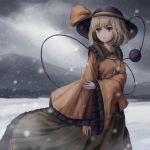 1girl ai_hajime bangs blush bow eyebrows_visible_through_hair frilled_shirt_collar frills green_eyes green_hair green_skirt hat hat_bow hat_ribbon highres komeiji_koishi long_sleeves mountain mountainous_horizon open_mouth ribbon shirt short_hair skirt snow snowing solo third_eye touhou wind wind_lift yellow_bow yellow_shirt