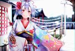 1girl absurdres alternate_costume arrow ema fate/grand_order fate_(series) floral_print flower furisode hair_flower hair_ornament hamaya hatsumoude highres holding_arrow japanese_clothes kimono long_hair looking_at_viewer new_year obi outdoors ponytail print_kimono red_eyes red_flower sash shrine silver_hair smile solo tomoe_gozen_(fate/grand_order) upper_body very_long_hair white_kimono yuu-kun_(linke_hand)