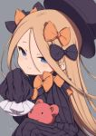 1girl abigail_williams_(fate/grand_order) bangs black_bow black_dress black_headwear blonde_hair blue_eyes blush bow commentary_request dress fate/grand_order fate_(series) forehead gamuo hair_bow hat highres long_hair long_sleeves looking_at_viewer orange_bow parted_bangs polka_dot polka_dot_bow simple_background sleeves_past_fingers sleeves_past_wrists solo stuffed_animal stuffed_toy teddy_bear very_long_hair