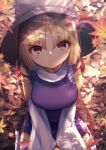 1girl bangs blonde_hair blurry blurry_background blurry_foreground breasts brown_headwear closed_mouth darumoon eyebrows_visible_through_hair from_above hands_together highres large_breasts leaf long_sleeves looking_at_viewer maple_leaf medium_hair moriya_suwako outdoors parted_bangs purple_vest seiza shirt sidelocks sitting smile solo thigh-highs touhou v_arms vest white_legwear white_shirt wide_sleeves yellow_eyes