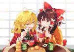 2girls :d absurdres bangs blonde_hair blush bow bowl braid brown_hair chopsticks commentary_request cup eating eyebrows_visible_through_hair food frilled_bow frills fruit green_neckwear hair_between_eyes hair_bow hair_tubes hakurei_reimu highres holding holding_bowl holding_chopsticks indoors japanese_clothes kirisame_marisa kotatsu long_hair long_sleeves looking_at_another multiple_girls no_hat no_headwear open_mouth orange plaid poprication red_bow red_eyes ribbon single_braid sitting smile steam table touhou yellow_eyes yellow_neckwear yunomi