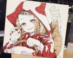 1girl animal_ears animal_hood bangs basket blush bow braid brown_hair capelet claw_pose commentary fake_animal_ears grin hands_up head_tilt highres holding holding_basket hood hood_up hooded_capelet little_red_riding_hood little_red_riding_hood_(grimm) long_sleeves looking_at_viewer nail_polish notice_lines parted_lips photo red_bow red_capelet red_eyes red_nails smile sofra solo swept_bangs symbol_commentary tail traditional_media wolf_ears wolf_girl wolf_hood wolf_tail