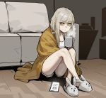 1girl animal_slippers bangs blanket blonde_hair bunny_slippers camisole commentary couch crossed_legs cup gogalking highres holding holding_cup looking_at_viewer mug original panties phone short_shorts shorts sitting slippers solo steam underwear white_panties wooden_floor