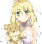1girl absurdres ahoge artoria_pendragon_(all) bangs bare_shoulders blonde_hair blush braid breasts collarbone commentary_request dress eyebrows_visible_through_hair fate/stay_night fate_(series) green_eyes hair_ribbon highres holding looking_at_viewer medium_breasts ribbon saber seijun-pb simple_background smile solo stuffed_animal stuffed_lion stuffed_toy white_background white_dress white_ribbon