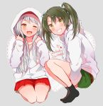 2girls alternate_costume anbutter_siruko bangs black_legwear blush character_name eyebrows_visible_through_hair green_eyes green_hair green_shorts grey_background grin hair_ribbon heart hood hood_down hood_up hooded_jacket hoodie jacket kantai_collection long_hair long_sleeves multiple_girls one_eye_closed open_mouth red_skirt ribbon shorts shoukaku_(kantai_collection) sitting skirt smile socks squatting twintails white_hair white_hoodie zuikaku_(kantai_collection)