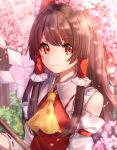1girl bangs blurry blurry_background bow breasts brown_hair cherry_blossoms commentary cravat day depth_of_field detached_sleeves eyebrows_visible_through_hair frilled_shirt_collar frills gohei hair_bow hair_tubes hakurei_reimu highres light_smile long_hair mozuno_(mozya_7) outdoors red_eyes red_vest ribbon-trimmed_sleeves ribbon_trim sidelocks small_breasts solo standing symbol_commentary touhou tree upper_body very_long_hair vest yellow_neckwear