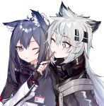 2girls absurdres animal_ear_fluff animal_ears arknights bangs black_capelet black_gloves black_hair black_jacket blush brown_eyes capelet commentary eyebrows_visible_through_hair fingerless_gloves food gloves grey_eyes hair_between_eyes hair_ornament hairclip hand_on_another's_head hand_up high_collar highres holding holding_food id_card jacket lappland_(arknights) long_hair long_sleeves looking_at_another looking_at_viewer moyume_(893604064) multiple_girls one_eye_closed pocky scar scar_across_eye sidelocks silver_hair simple_background texas_(arknights) upper_body white_background wolf_ears