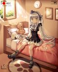 1girl absurdres bangs bed black_ribbon blunt_bangs blush clock commentary_request eyebrows_visible_through_hair facial_mark girls_frontline green_eyes hair_ornament hair_ribbon hat highres hk416_(girls_frontline) huge_filesize indoors long_hair long_sleeves looking_at_viewer on_bed pillow recording ribbon silver_hair sitting socks solo stuffed_animal stuffed_toy teddy_bear very_long_hair wabbajack window