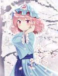 1girl arm_garter arm_up blue_headwear blue_kimono blurry blurry_background blurry_foreground blush cherry_blossoms commentary_request depth_of_field expressionless hand_in_hair hat hitodama japanese_clothes kimono lens_flare light_particles long_sleeves looking_at_viewer mob_cap nibosisuzu partial_commentary pink_eyes pink_hair saigyouji_yuyuko short_hair standing touhou tree triangular_headpiece upper_body wide_sleeves