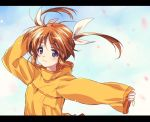1girl bangs blue_sky blurry closed_mouth clouds cloudy_sky commentary day eyebrows_visible_through_hair hair_ribbon hand_on_own_head highres kuroi_mimei letterboxed light_blush light_particles long_sleeves looking_at_viewer lyrical_nanoha orange_shirt outdoors petals ribbon shirt short_hair sky sleeves_past_wrists smile solo takamachi_nanoha twintails upper_body white_ribbon wind