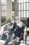 1girl absurdres azur_lane black_coat blue_pants blush book breasts casual coat computer cup enterprise_(azur_lane) eyebrows_visible_through_hair full_body hat highres hsh_thx indoors laptop large_breasts long_hair looking_at_viewer office pants peaked_cap scenery silver_hair sitting smile solo sweater violet_eyes white_sweater window