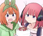 2girls :d bangs birthday_cake black_ribbon blue_eyes blue_sailor_collar blush cake closed_mouth collarbone commentary_request eyebrows_behind_hair food fruit go-toubun_no_hanayome green_hoodie hair_between_eyes hair_ribbon highres holding hood hood_down hoodie kujou_karasuma multiple_girls nakano_nino nakano_yotsuba open_mouth orange_hair pink_background redhead ribbon sailor_collar simple_background smile strawberry upper_body upper_teeth