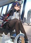 1girl animal_ears arknights black_hair black_legwear brown_eyes cat chin_rest commentary_request fingerless_gloves food food_in_mouth gloves hair_between_eyes highres long_hair long_sleeves pantyhose pocky ran'ou_(tamago_no_kimi) shorts solo texas_(arknights) wolf_ears